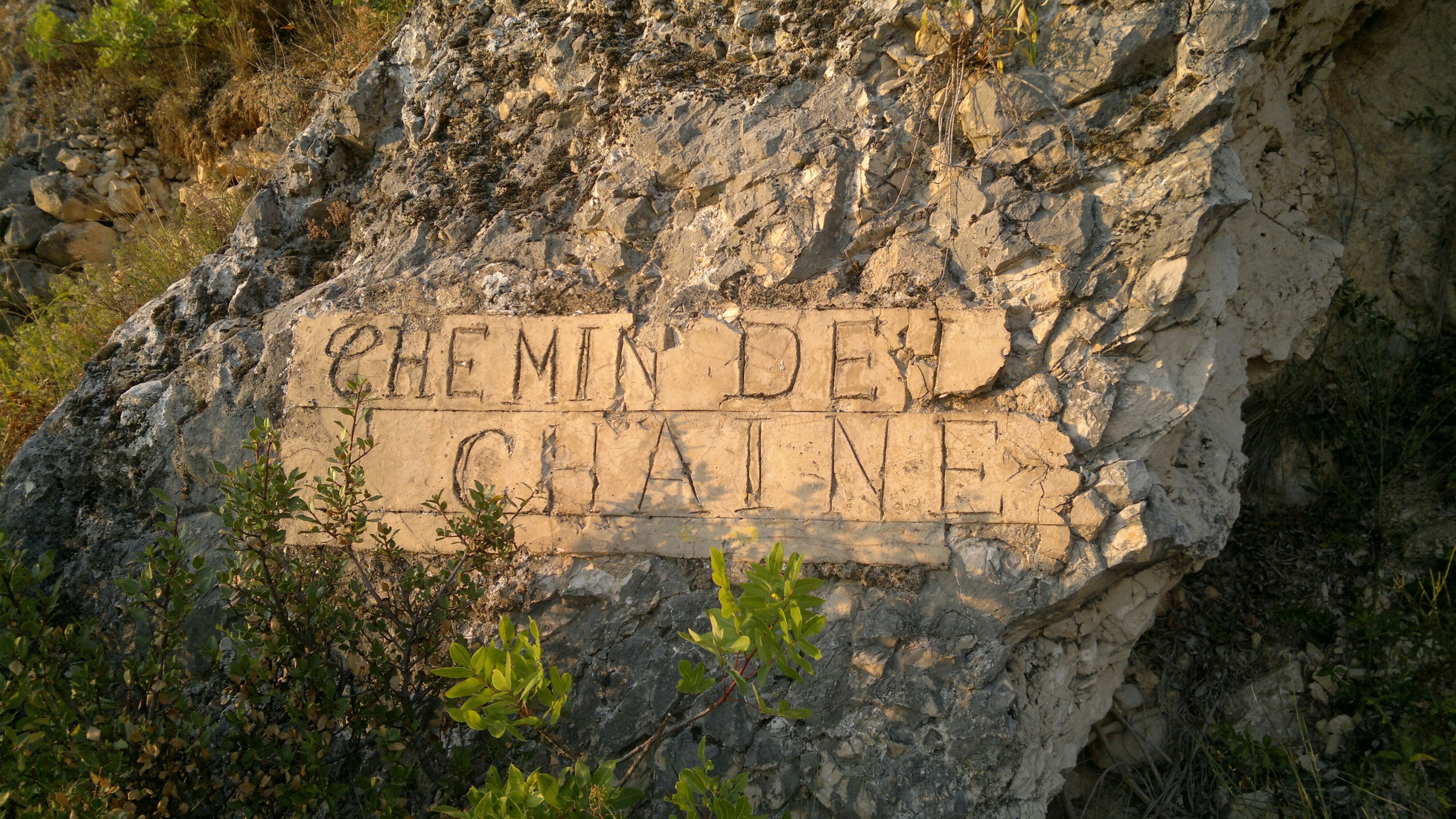 Text Carved On Rock