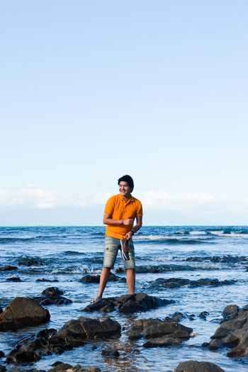 Kuya Beach Beauty In Nature Casual Clothing Clear Sky Copy Space Day Full Length Getting Away From It All Horizon Over Water Leisure Activity Lifestyles Nature Relaxation Rock - Object Scenics Sea Shore Standing Summer Tranquil Scene Tranquility Vacations Water Wave Young Adult