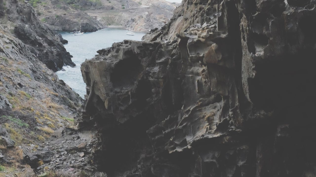 rock formation, rock - object, cliff, geology, rock, nature, physical geography, mountain, no people, steep, day, water, sea, scenics, beauty in nature, outdoors, rock face, scenery