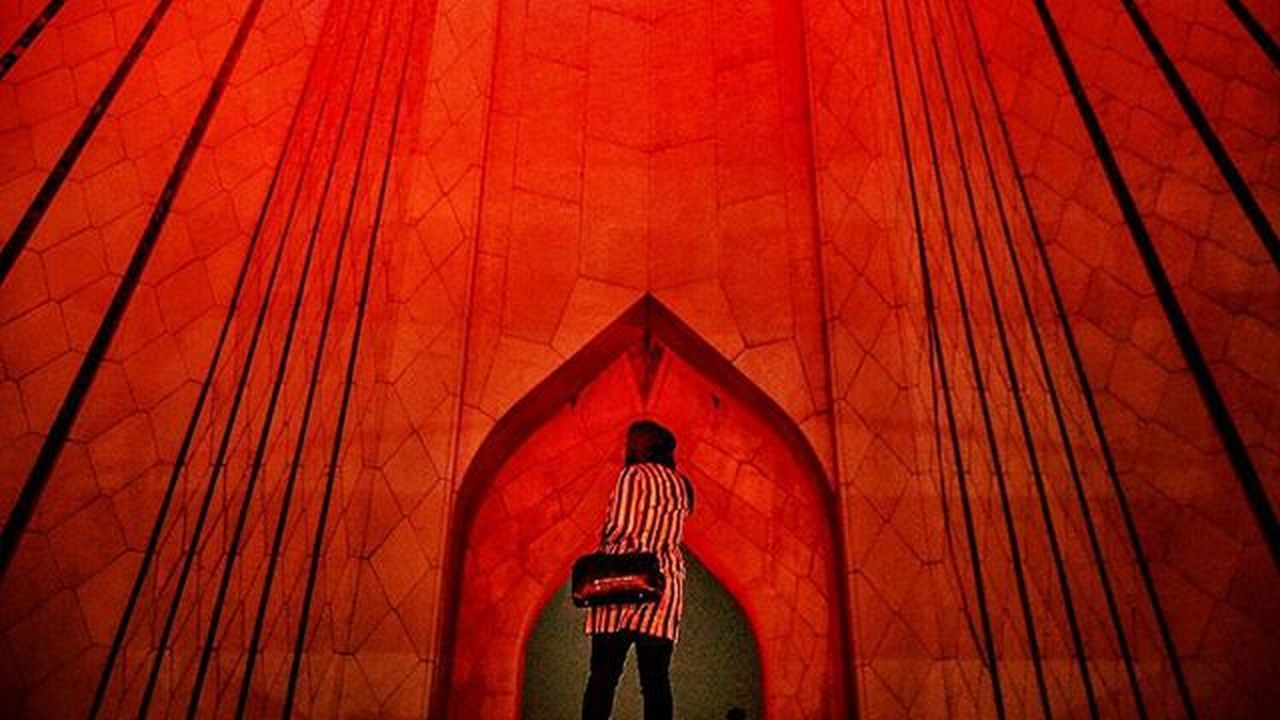 Azaditower Tehran Iran Red Woman Streetphotography2015 Documentaryphotography Documentary Gettyimages Roozdaily Colorful Nightlife