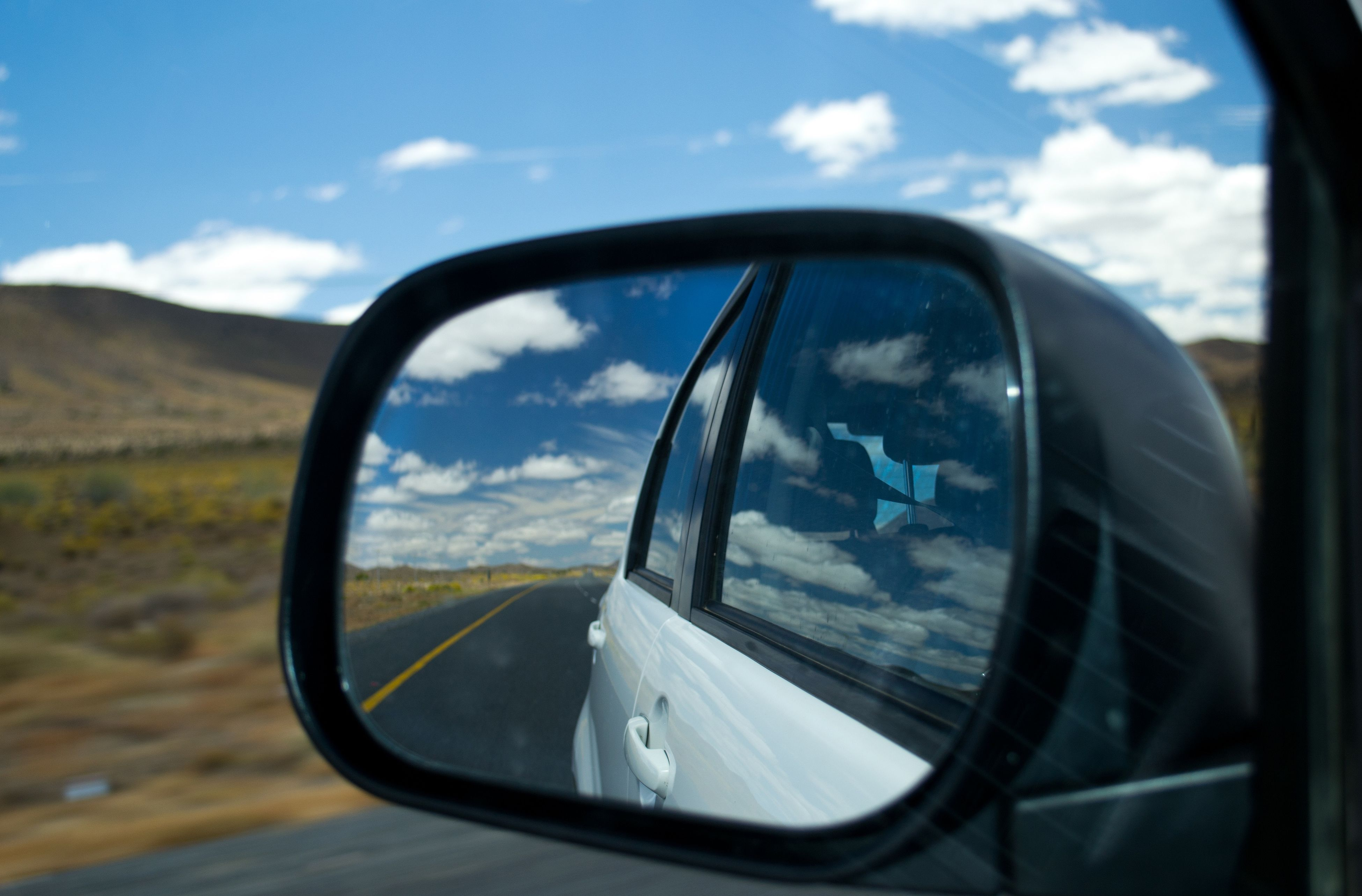 transportation, mode of transport, side-view mirror, land vehicle, car, sky, reflection, vehicle interior, glass - material, transparent, road, part of, cloud - sky, car interior, cropped, cloud, close-up, travel, street, landscape