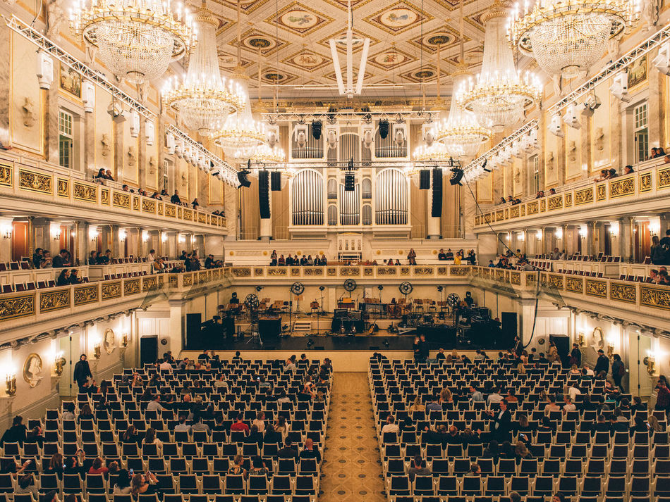 Architecture Arts Culture And Entertainment Chandelier Concert Hall  Indoors  Large Group Of People Leisure Activity People Wealth