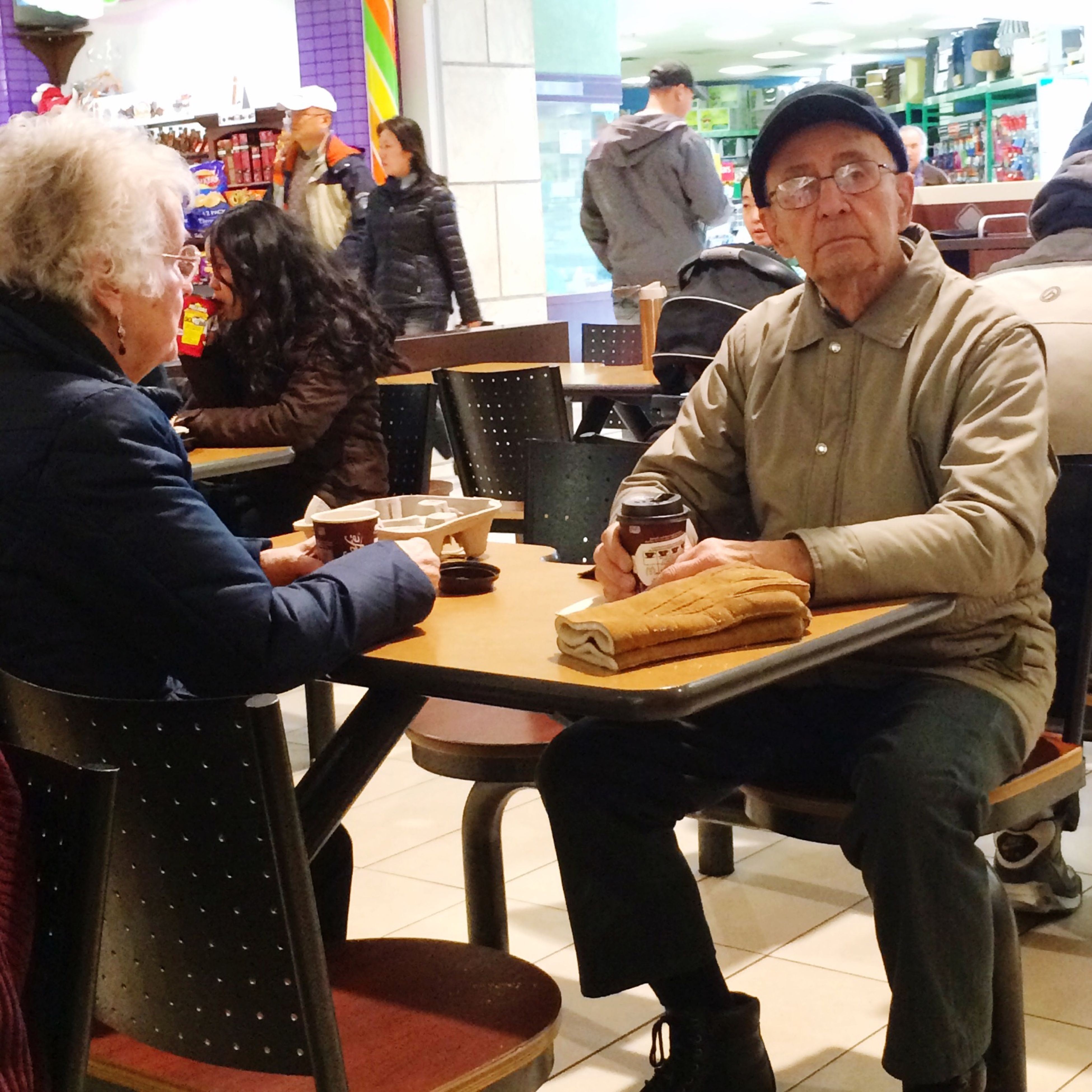 indoors, lifestyles, sitting, casual clothing, togetherness, men, leisure activity, friendship, table, working, bonding, chair, restaurant, young men, person