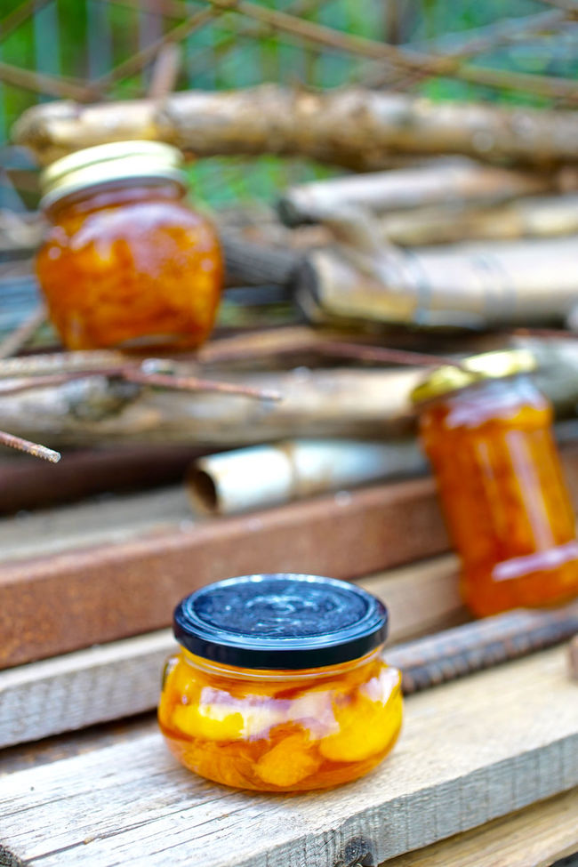 Selective Focus Beauty In Nature Orange Color Focus On Foreground Food And Drink Food Ready-to-eat Peaches Fruit Wood - Material Peach Jam Jam Jars  Jar Autumn Colors Autumn Large Group Of Objects Group Of Objects Wooden