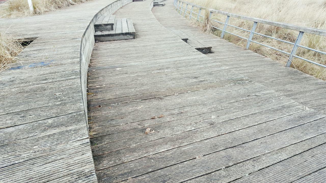 Wooden Boardwalk On Sunny Day
