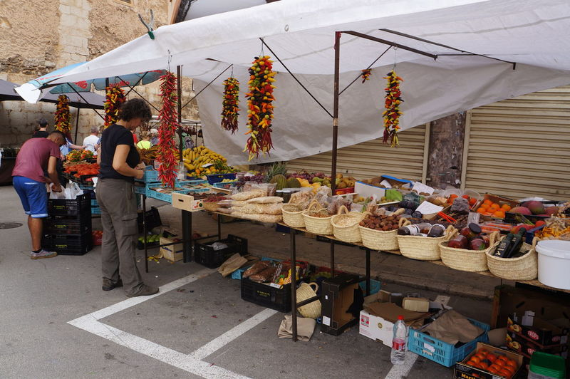 Market stall, Inca, Spain Adult Business Chilli Papers Choice Choosing City Customer  Food Food And Drink For Sale Freshness Horizontal Market Market Stall Market Vendor Men Outdoors Person Retail  Selling Small Business Street Food Street Market Variation Vendor