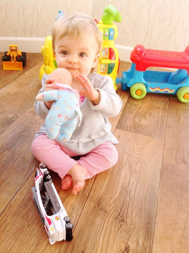 Childhood Toddler  Cute Elementary Age Babyhood Innocence Baby Girls Portrait Person Baby Looking At Camera Indoors  Full Length Baby Clothing Front View Fun Hardwood Floor Day Unknown Gender