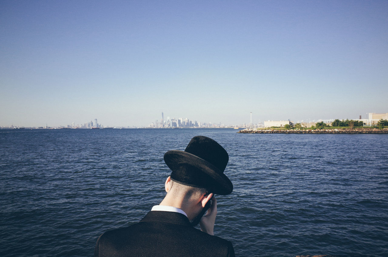 The world seen from behind Backhead Behind Escapism Getting Away From It All Hat Horizon Horizon Over Water New York City Ocean Outdoors Prayer Real People Rear View Rippled Sea The World Seen From Behind Water