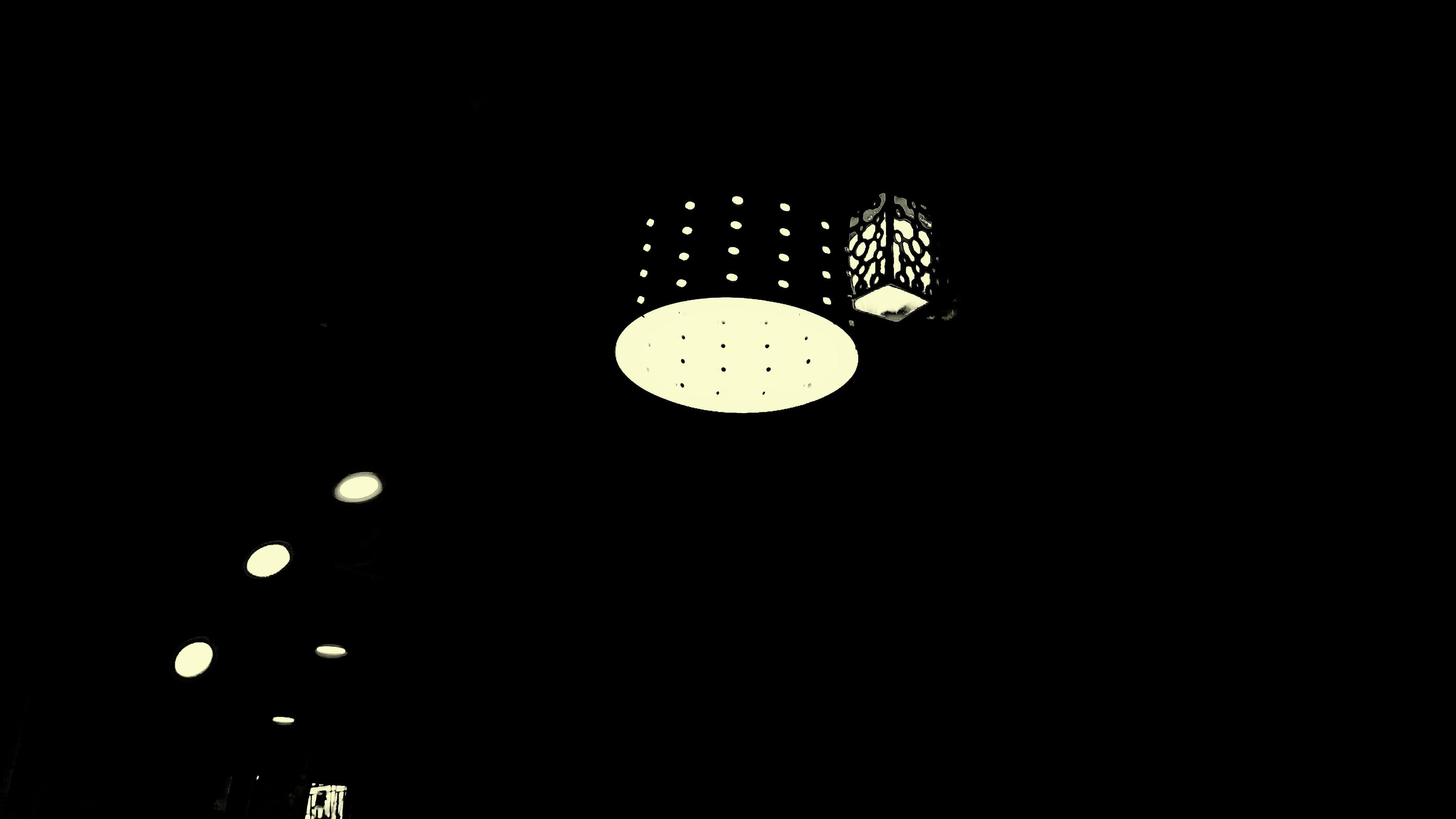 lighting equipment, illuminated, night, no people, copy space, dark, low angle view, light bulb, black background, studio shot, indoors, close-up