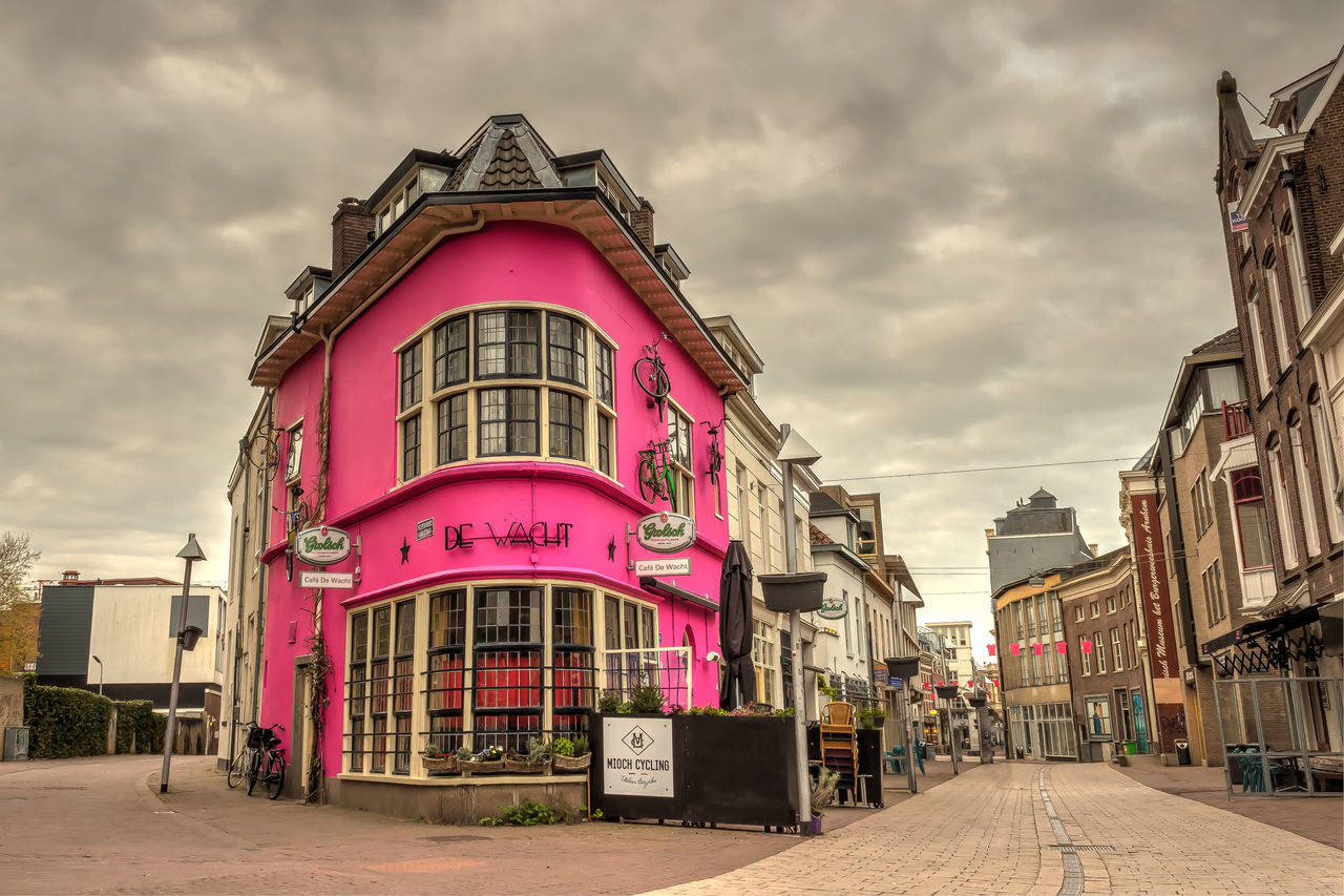 Café De Wacht painted pink to support the Giro d'Italia 2016, starting in Arnhem Architecture Building Exterior Built Structure Cafe City City Life Cloud Cloud - Sky Cloudy Day Exterior Façade Giro D'Italia Giro D'Italia 2016 No People Outdoors Overcast Pink Color Residential Building Sky The Way Forward Walkway Weather