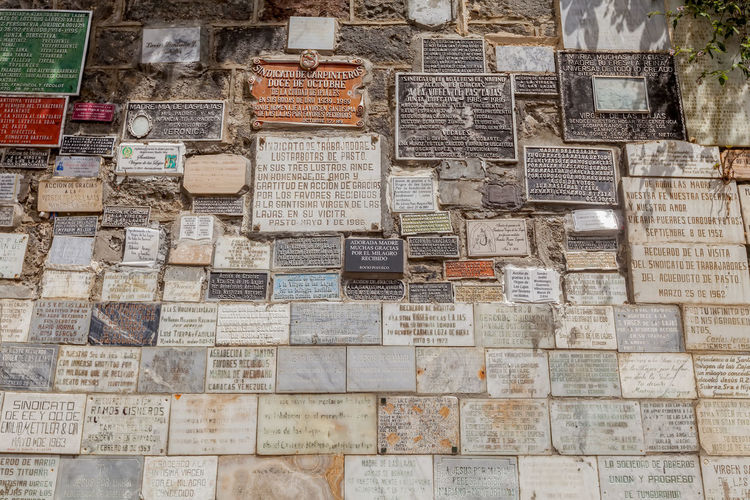 Ipiales, Colombia - 11 September 2016: Marble Plates With The Religious Texts Of The Las Lajas Catholic Church, Built Inside The Canyon Of The Guaiatara River, South America Art Cathedral Catholic Catholic Church Catholicism Colombia Day Faith Gothic Gothic Style Las Lajas Las Lajas Cathedral Marble Marbledstone No People Outdoors Peace Pray Religion Religion And Beliefs Religious  Religious Architecture Religious Art South America Text