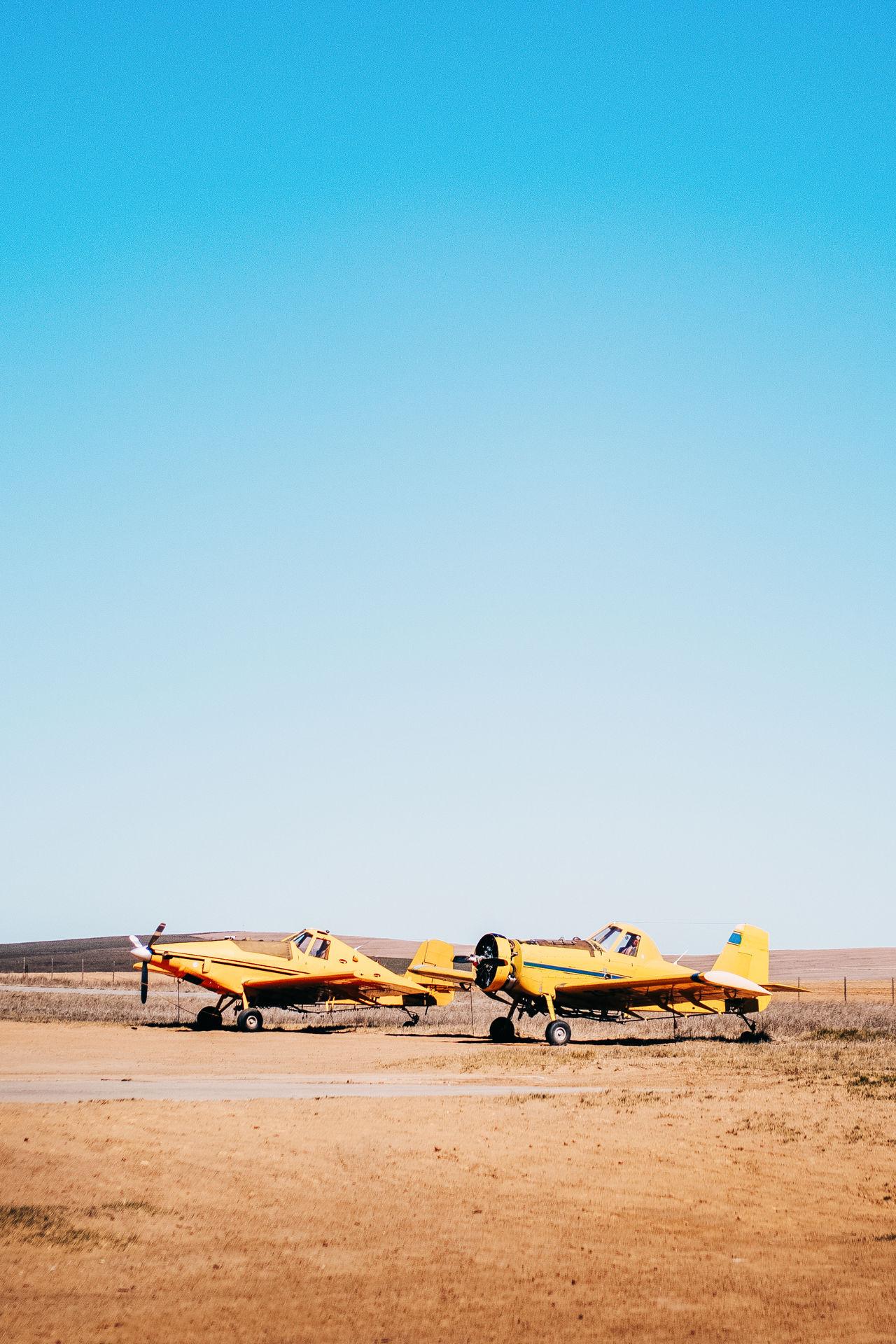 Airplane Blue Clear Sky Copy Space Day Desert Landscape People Plane Sky Transportation