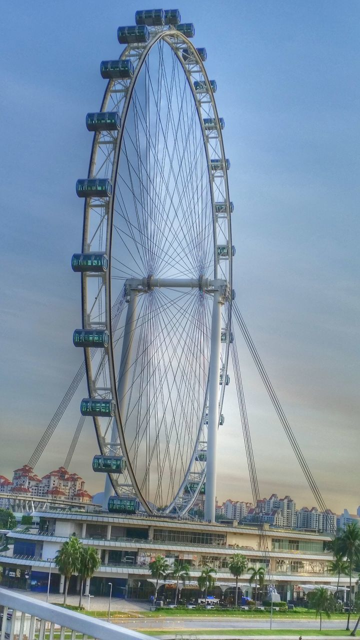 amusement park, ferris wheel, arts culture and entertainment, architecture, built structure, big wheel, low angle view, amusement park ride, sky, no people, outdoors, day, building exterior