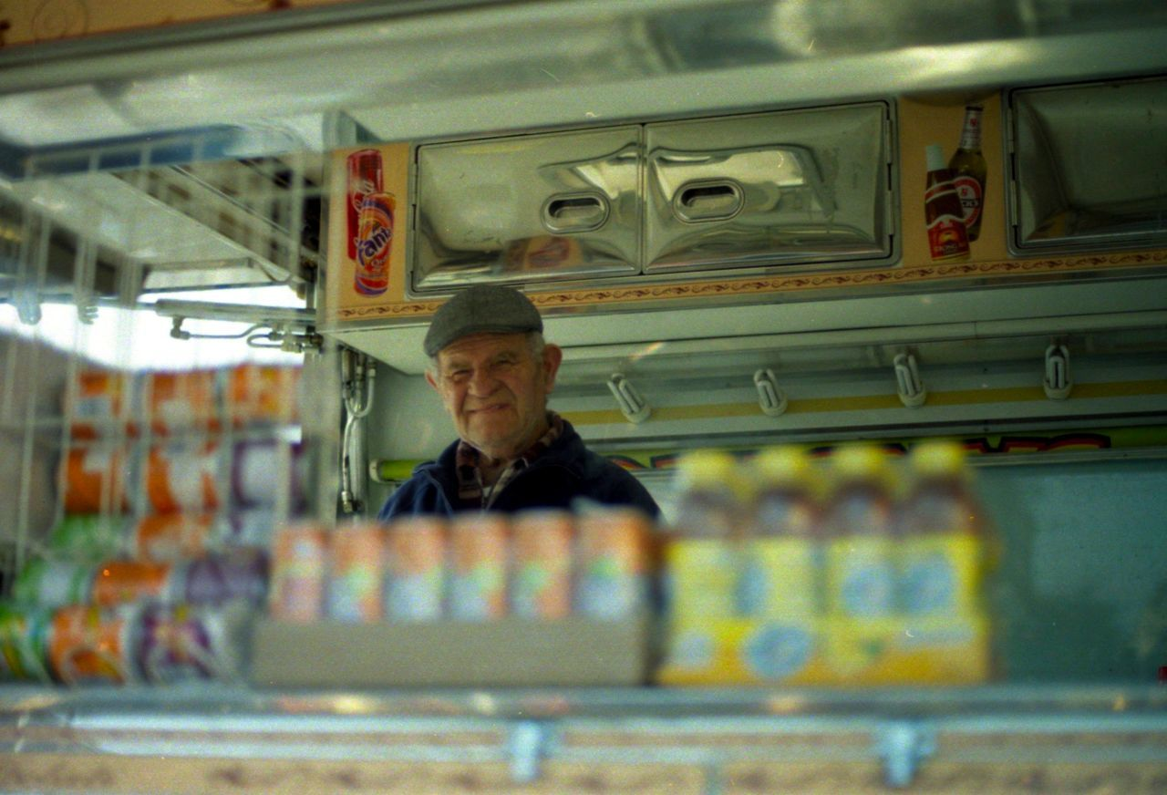 A guy selling ice cream Analog Business Day Grandfather Happiness Ice Cream Italy Old Man One Person People Portrait Rome S Shadow Smile