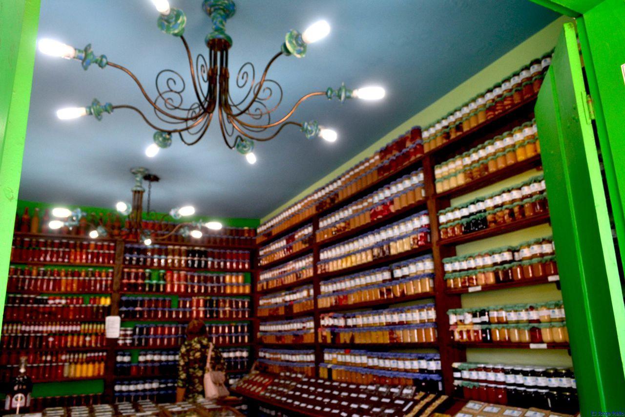 shelf, book, indoors, library, bookshelf, education, large group of objects, illuminated, choice, architecture, no people, day