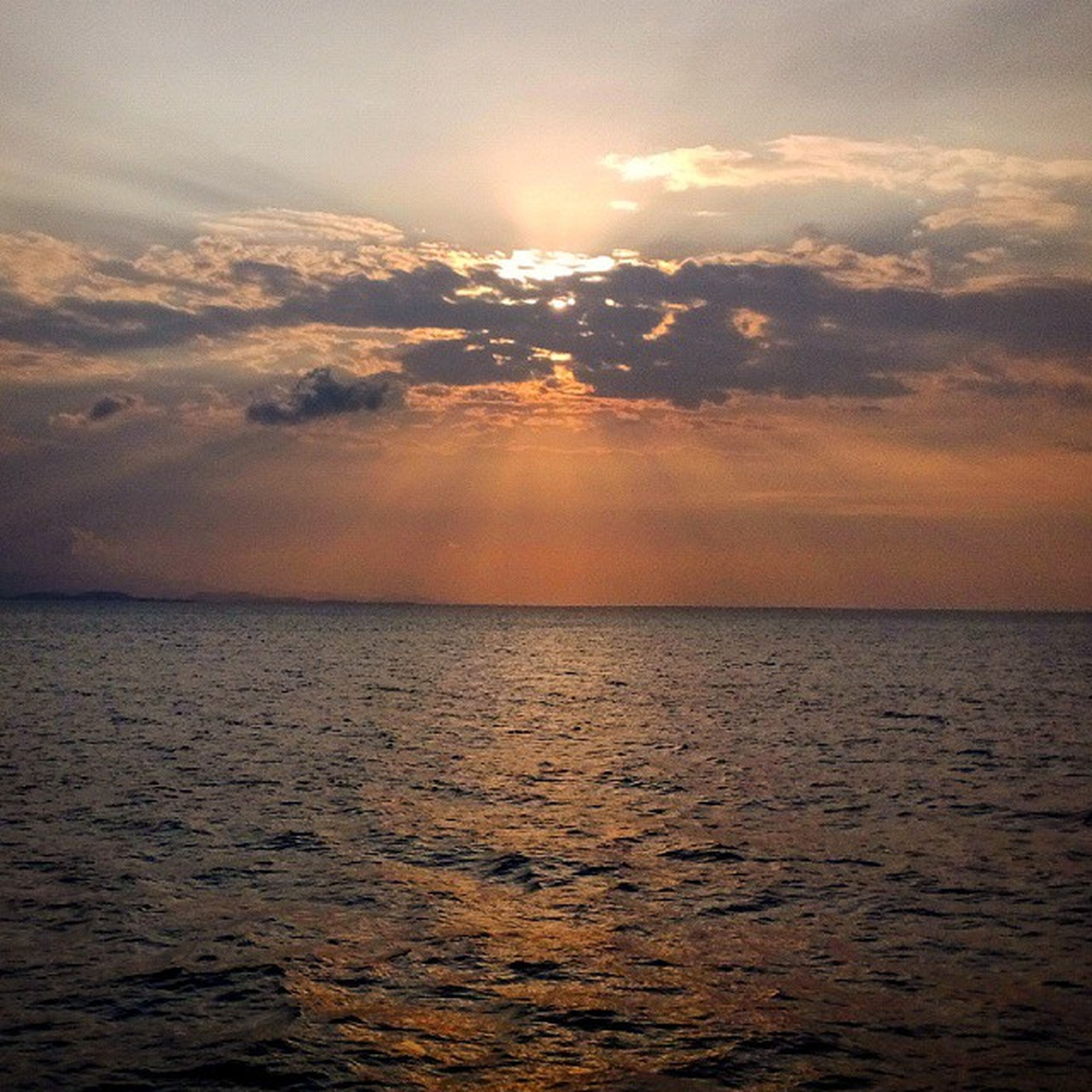 sea, sunset, water, scenics, tranquil scene, beauty in nature, sky, horizon over water, tranquility, waterfront, idyllic, nature, cloud - sky, rippled, seascape, orange color, sun, cloud, outdoors, dramatic sky