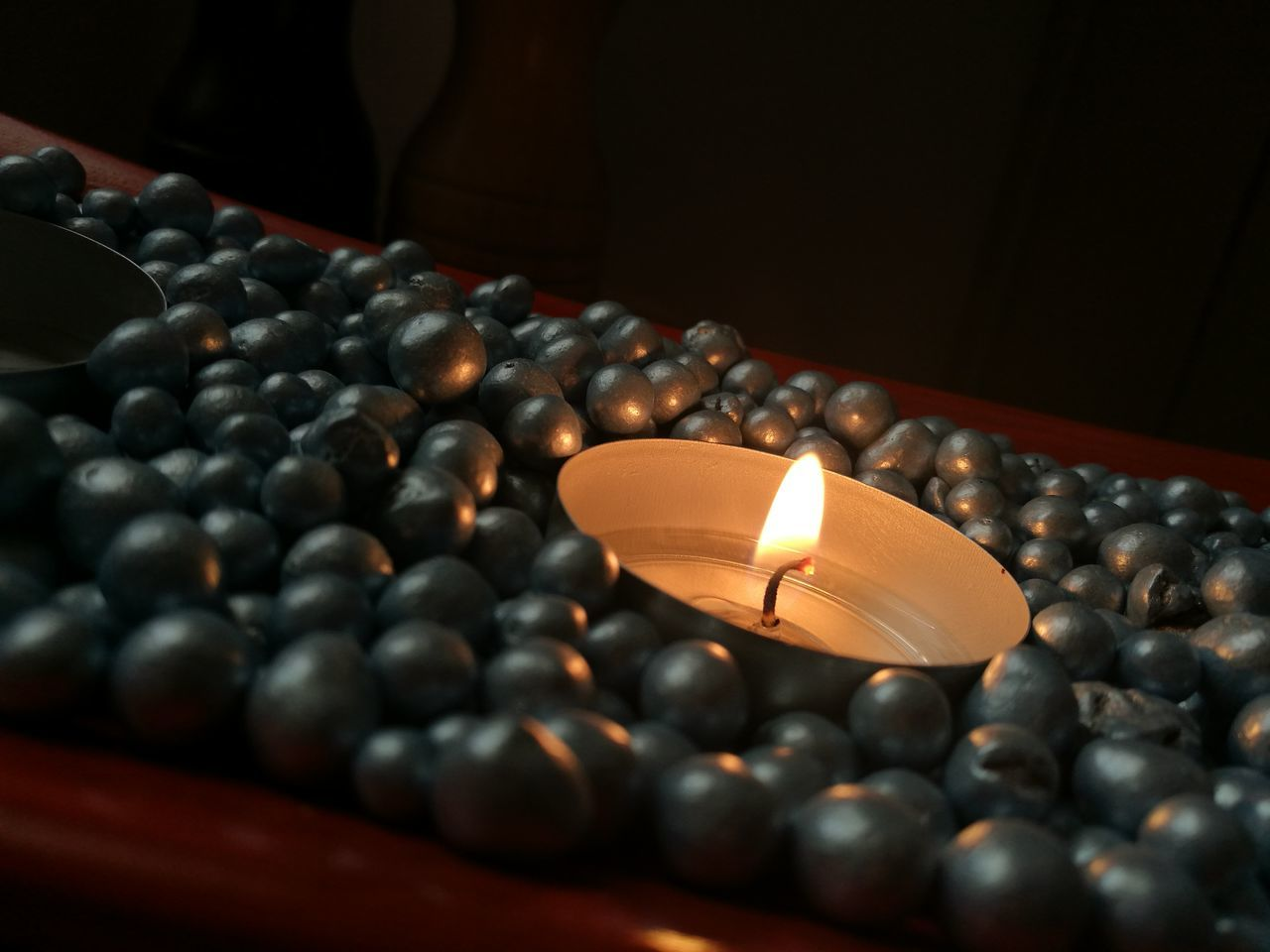 candle, flame, indoors, no people, large group of objects, close-up, illuminated, day