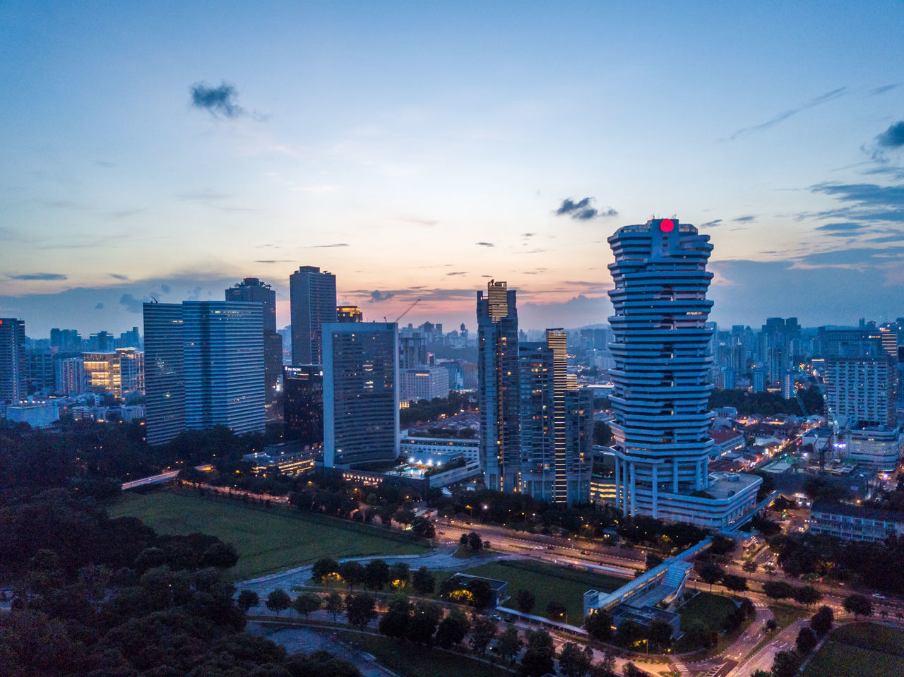 Architecture Building Exterior Built Structure City Cityscape Cloud - Sky Day Drone  Dronephotography Growth High Angle View Illuminated Modern No People Outdoors Singapore Sky Skyscraper Sunset Travel Destinations Urban Skyline