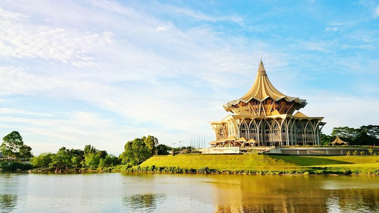 architecture, built structure, sky, cloud - sky, religion, spirituality, building exterior, place of worship, travel destinations, tree, water, history, waterfront, outdoors, lake, day, no people, scenics, nature, dome