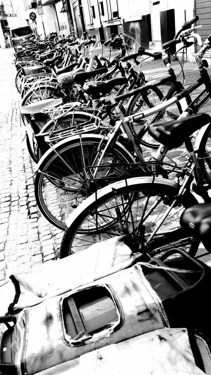 bicycle, mode of transport, transportation, land vehicle, stationary, outdoors, day, bicycle rack, no people, close-up, city