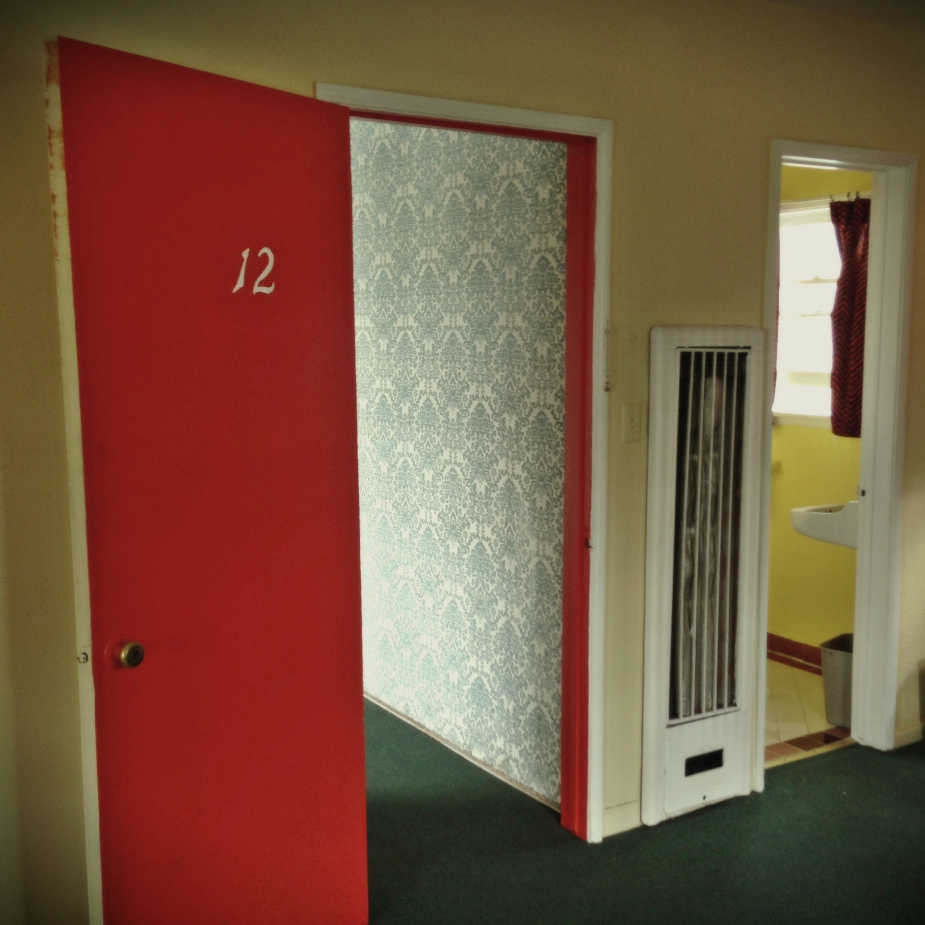 indoors, red, door, built structure, home interior, architecture, house, communication, window, wall - building feature, wall, text, closed, yellow, day, domestic room, office, open