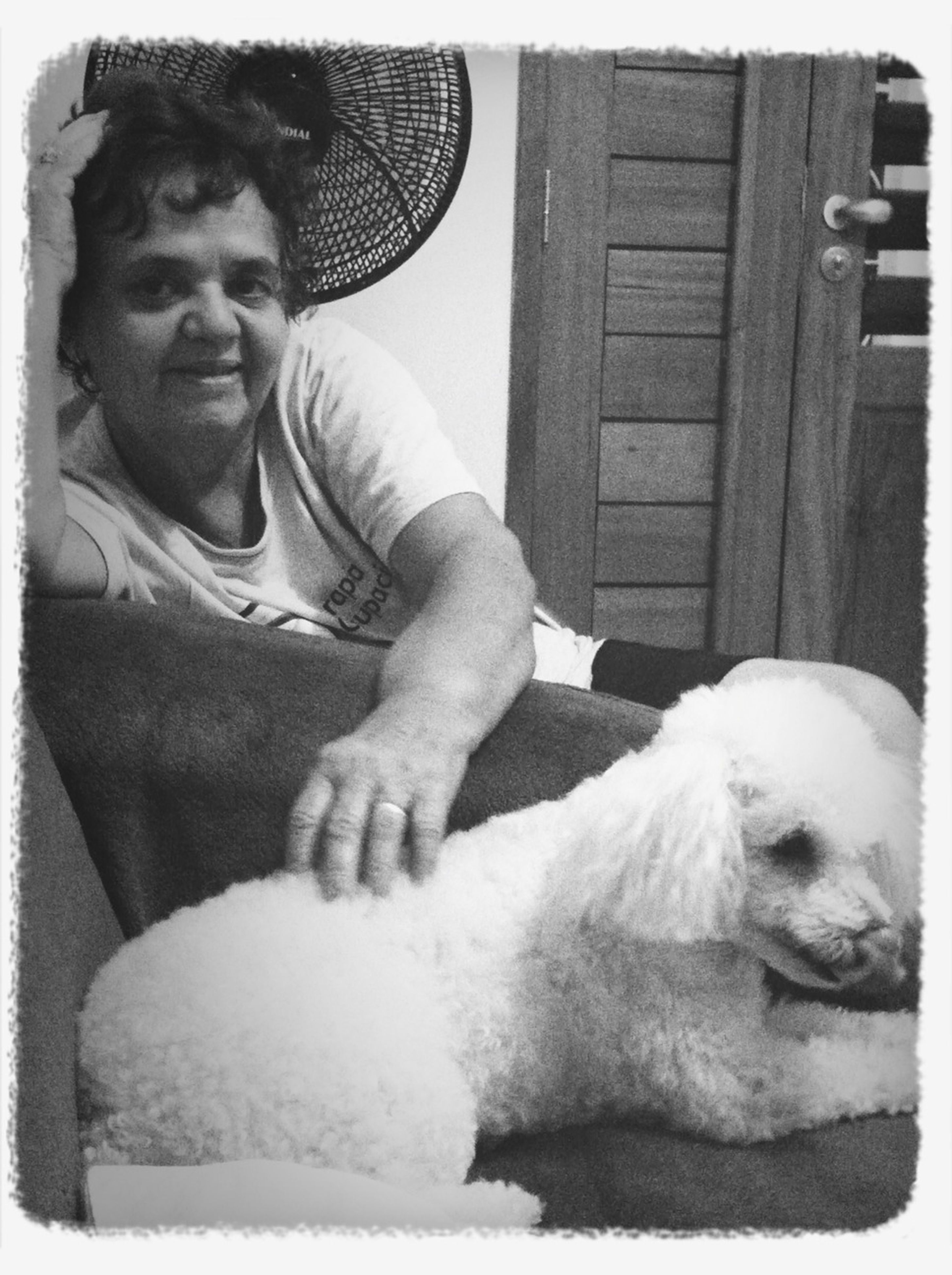transfer print, auto post production filter, lifestyles, sitting, relaxation, person, leisure activity, dog, young men, togetherness, young adult, side view, indoors, bonding, mid adult, men, love, domestic animals