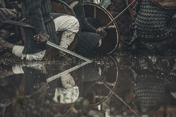 Early medieval fighters waiting - kneeling in the water before the fight Armor Chainmail Dark Fighter Fighters Gambeson Gloomy History Kneeling Medieval Men Messy Outdoors Rain Reflection Ship Slavic Sneaking Sword Viking War Warrior Water Water Reflections Wet First Eyeem Photo