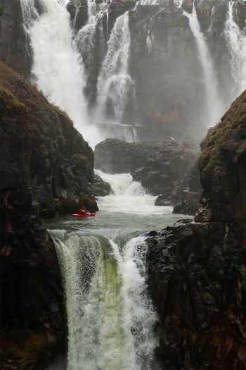 Kayaker waiting to drop over White River Falls in Oregon. Waterfall Water Motion Rock Kayak Kayaking Outdoors Adventure Oregon Central Oregon Pacific Northwest  Day White River Falls