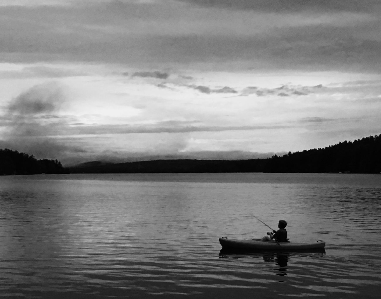 Peaceful evening on the lake in Denmark Maine Water Lake Nature Sitting One Person Sky Cloud - Sky Tranquility Blackandwhite Bnw Outdoors Real People Leisure Activity Tranquil Scene Scenics Men Day Mountain Raft Lifestyles Tree Maine