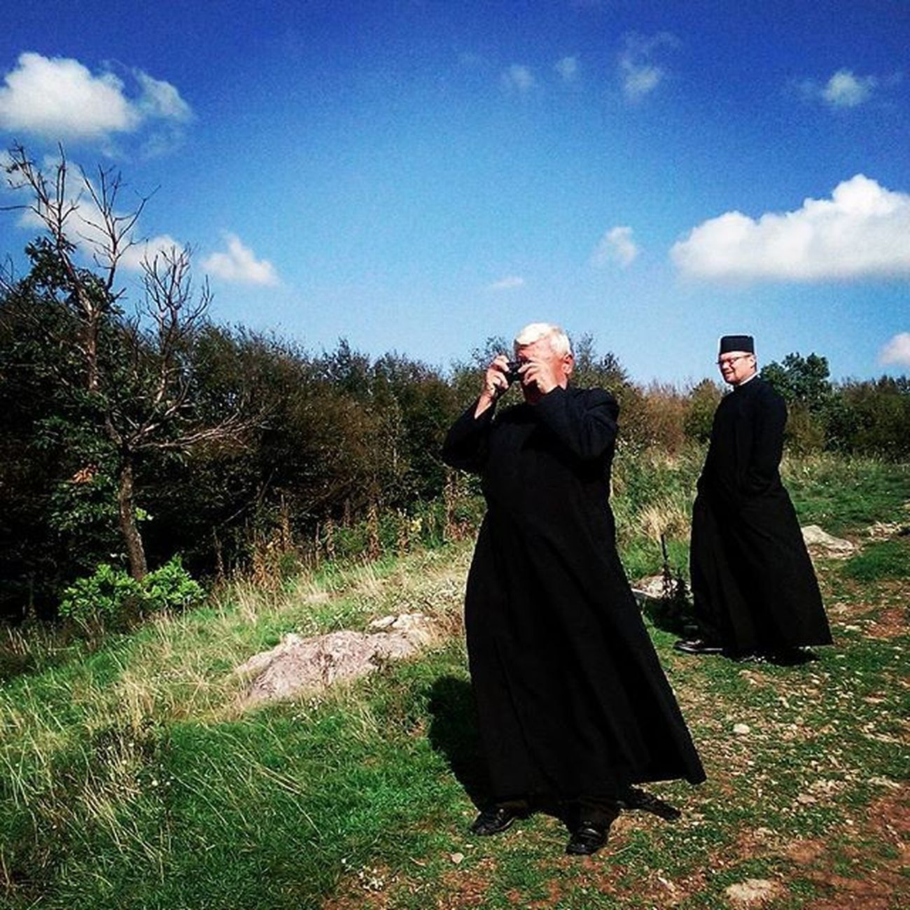 Orthodox priest takes a photo with a compact film camera. Siria, Romania, 2015. Photo by Ciprian Hord/@ciprianhord for @everydayeasterneurope Everydayeverywhere Romania Ciprianhord Outofthephone Priest LCStories