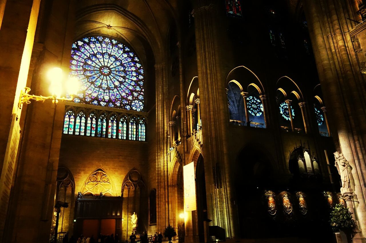 Low Angle View Of Illuminated Notre Dame De Paris At Night