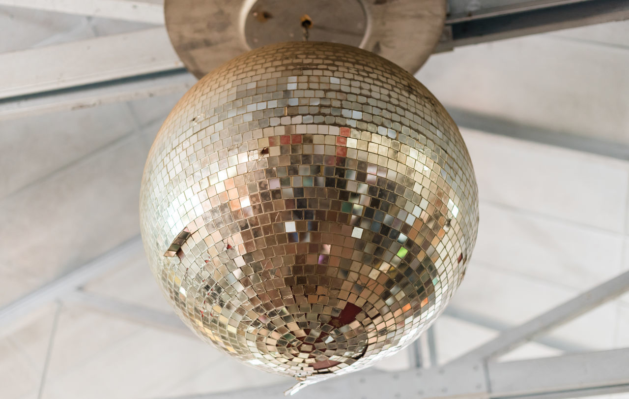 Aged and damaged disco ball - aging concept Ceiling Celebration Close-up Damaged Day Disco Ball Hanging Indoors  Low Angle View Nightclub No People Old Reflection Rustic Shiny Vintage