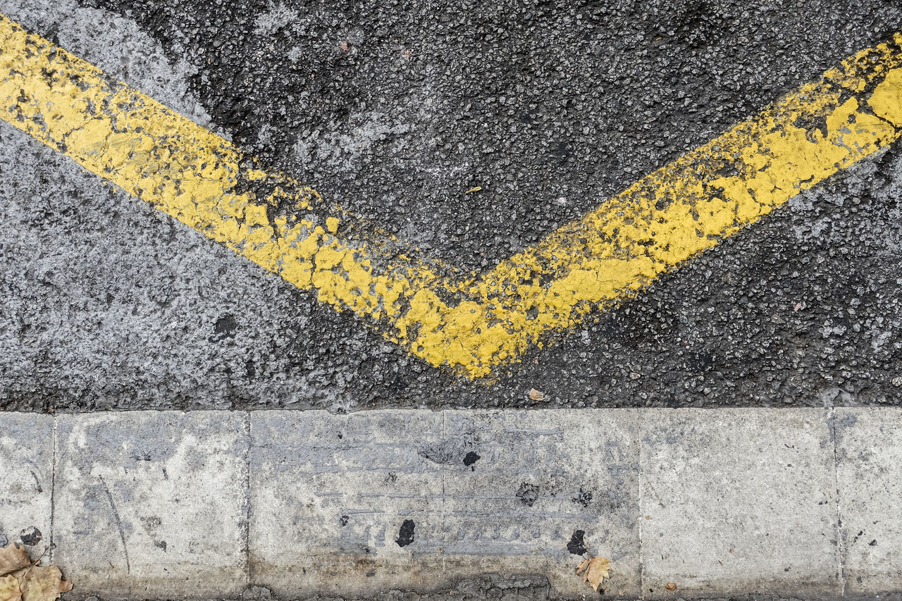 yellow, asphalt, road, road marking, transportation, street, textured, day, outdoors, no people, communication, backgrounds, close-up, city