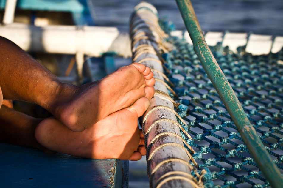 Adult Adults Only Boat Close-up Day Feet Fisherman Foot Human Body Part Human Foot Human Hand Human Leg Low Section Man Resting Man Sleeping One Man Only One Person Only Men Outdoors People