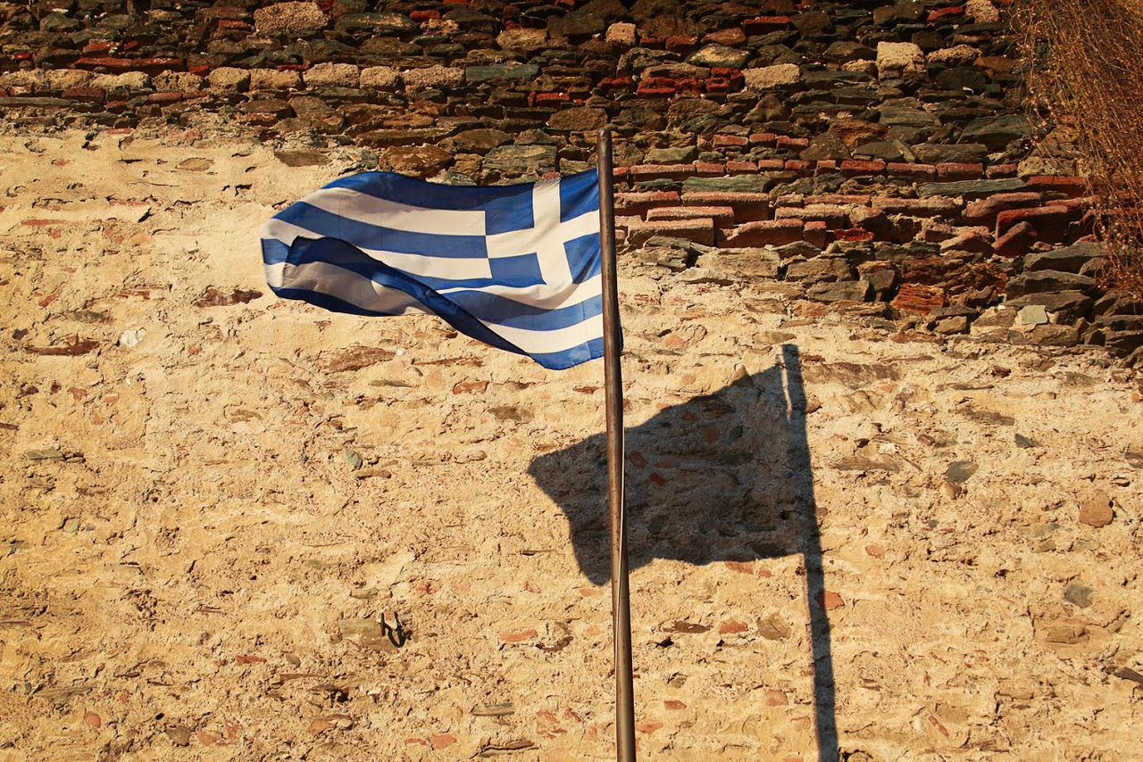 Flag Flag Background Close-up Day Flag In The Wind Flag With Cross Greece Greece Flag Greek Greek History Greek Islands Greek Symbols Greek Village Ground Lines And Shapes Nature No People Old Buildings Old Town Old Wall Outdoors Wall Wall With Flag White Flag Wind