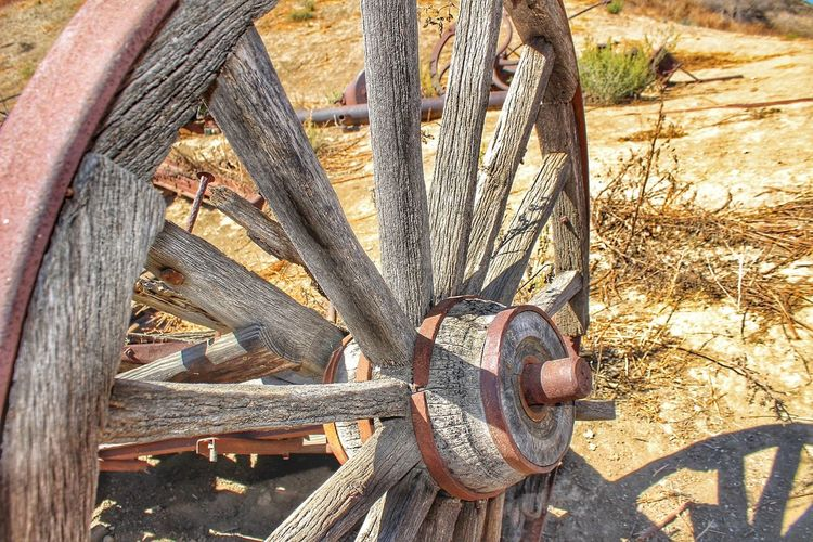 Broke Down Vintage Wagon Wheel Wood Rust Cracked Frame Abandoned In The Desert Outdoors Close-up Shades Of Brown Transportation History