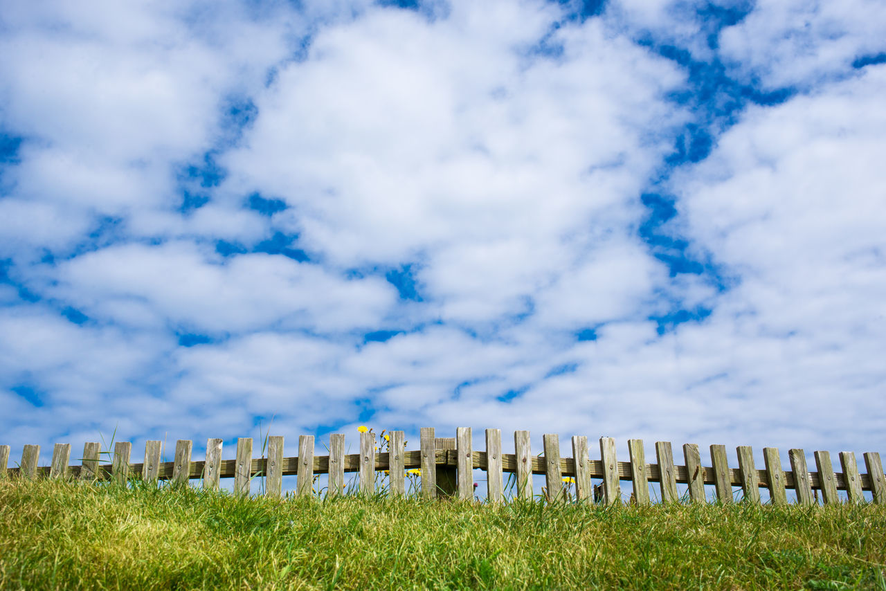 Beauty In Nature Beyond Blue Cloud - Sky Countryside Day Fairytale  Fence Grass Nature No People Outdoors Sky Spring Wooden Fence