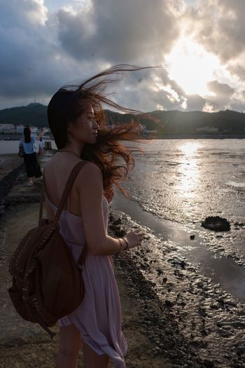 Togetherness Young Adult Friendship Water Sea Beach Real People One Person Sky Side View Cloud - Sky Long Hair Sunset Young Women Nature Outdoors Leisure Activity Lifestyles Standing Sand Beauty In Nature Beautiful Woman