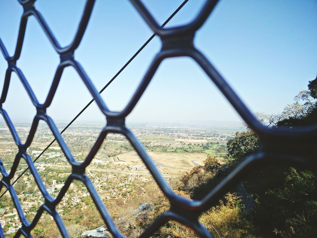 chainlink fence, day, landscape, no people, airplane, sky, clear sky, outdoors, nature, tree, close-up