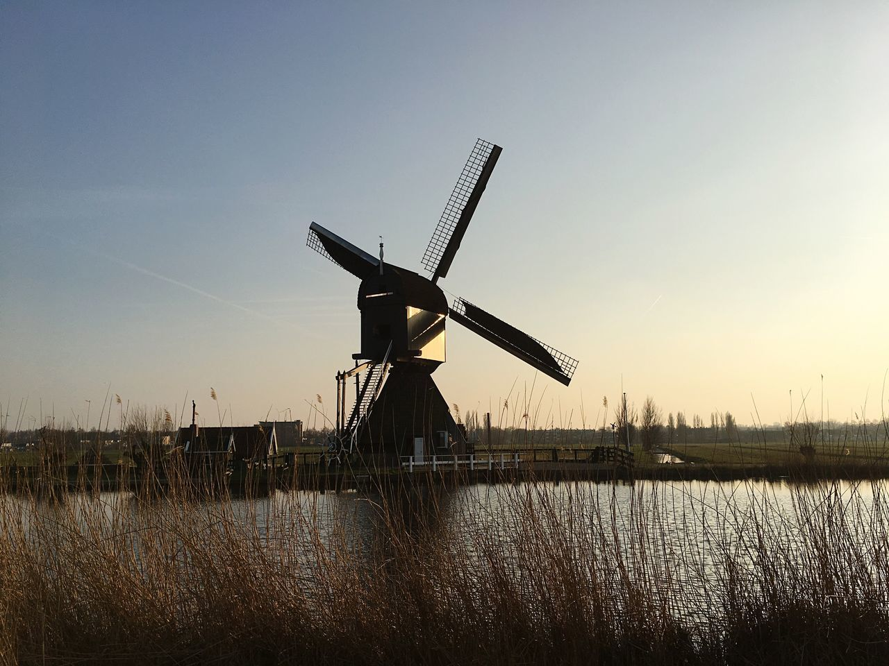 wind power, alternative energy, wind turbine, windmill, renewable energy, fuel and power generation, environmental conservation, traditional windmill, industrial windmill, nature, sky, outdoors, rural scene, no people, water, field, clear sky, day, lake, scenics, technology, architecture, beauty in nature
