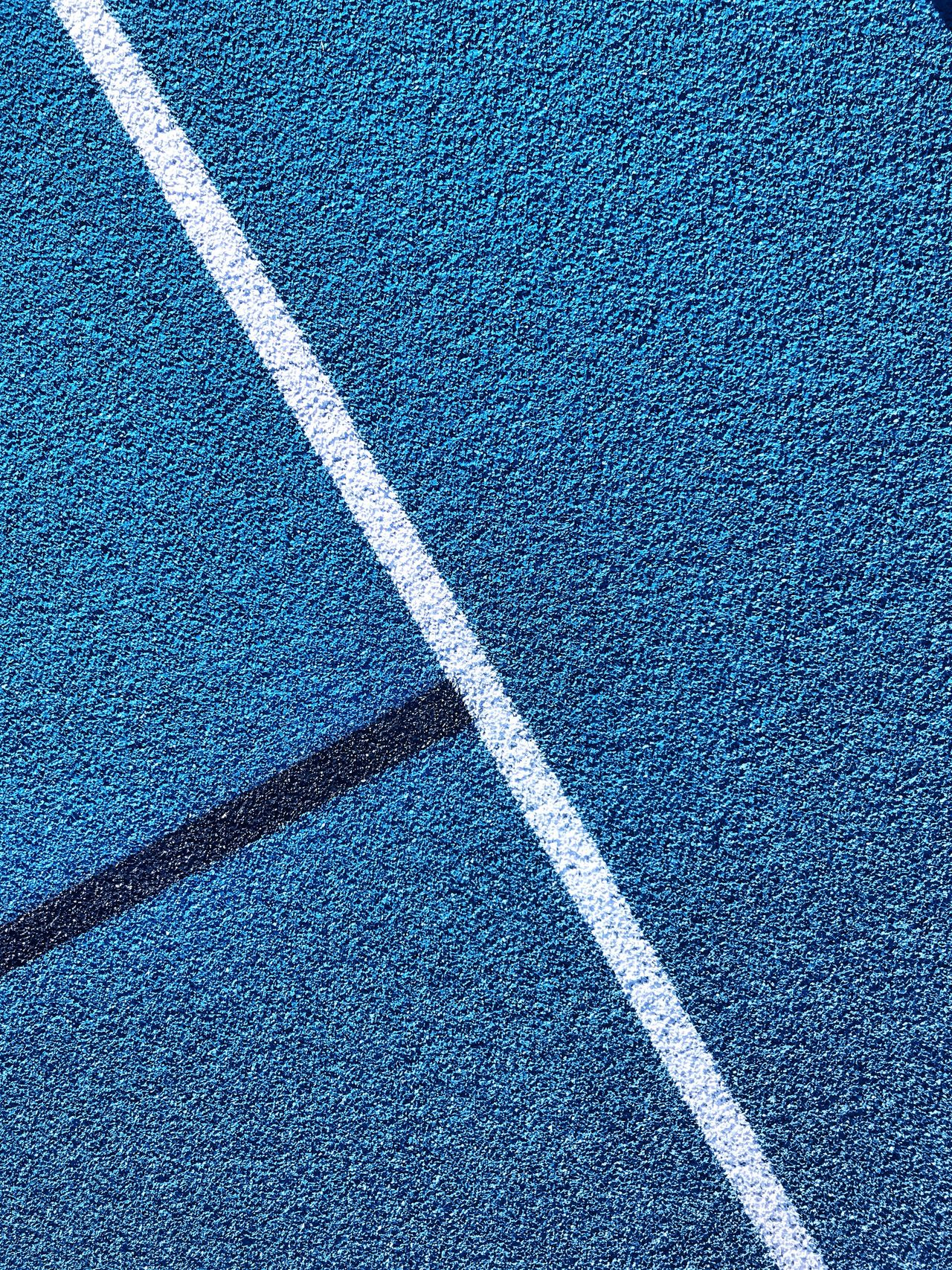 Backgrounds Pattern Full Frame Day Textured  No People Blue Outdoors Running Track Stadium Track And Field Athletics College University Blue Color LINE Abstract Track Textured  Running Jumping Hurdles Detail Sports Dominant Color