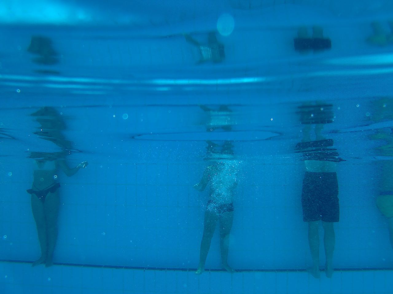 Underwater Shot Of Children In Swimming Pool