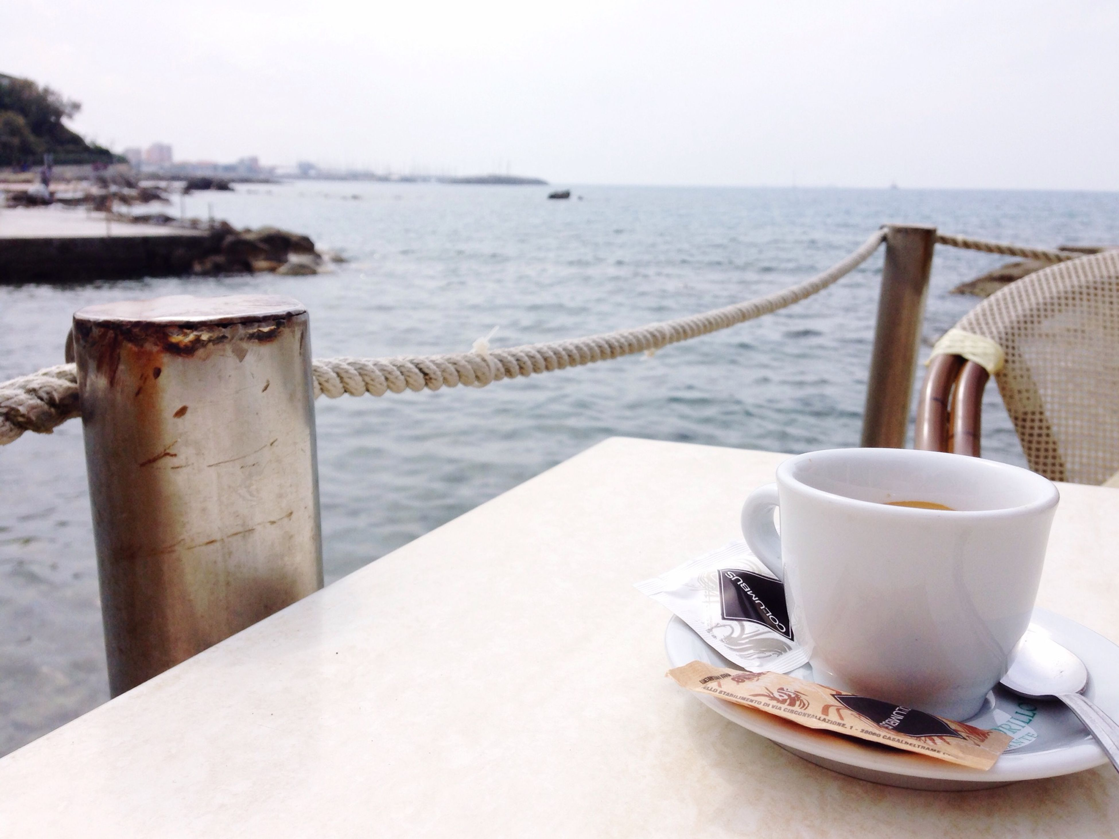 coffee cup, water, drink, food and drink, refreshment, sea, table, saucer, coffee - drink, coffee, horizon over water, close-up, focus on foreground, cup, day, no people, wood - material, still life, freshness, wooden