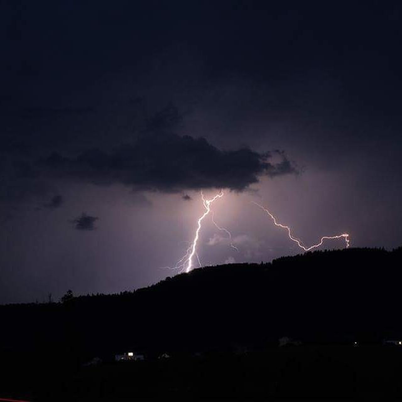 lightning, thunderstorm, power in nature, forked lightning, storm, night, danger, dramatic sky, weather, storm cloud, illuminated, nature, sky, scenics, silhouette, vitality, beauty in nature, no people, electricity, outdoors, tree