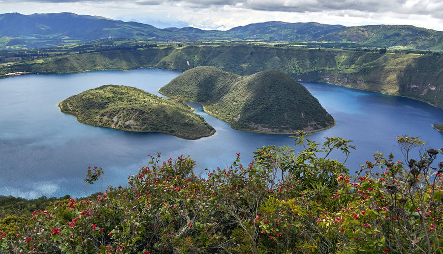 Laguna Cuicocha (Guinea Pig Lake) is a spectacular sight in person Laguna Lakeview Vista Beauty In Nature Crater Cuicocha Day Geology Lake Landscape Mountain Nature No People Outdoors Physical Geography Scenics Sky Tourism Tranquil Scene Tranquility Tree Vacation Destination Wallpaper Water Perspectives On Nature