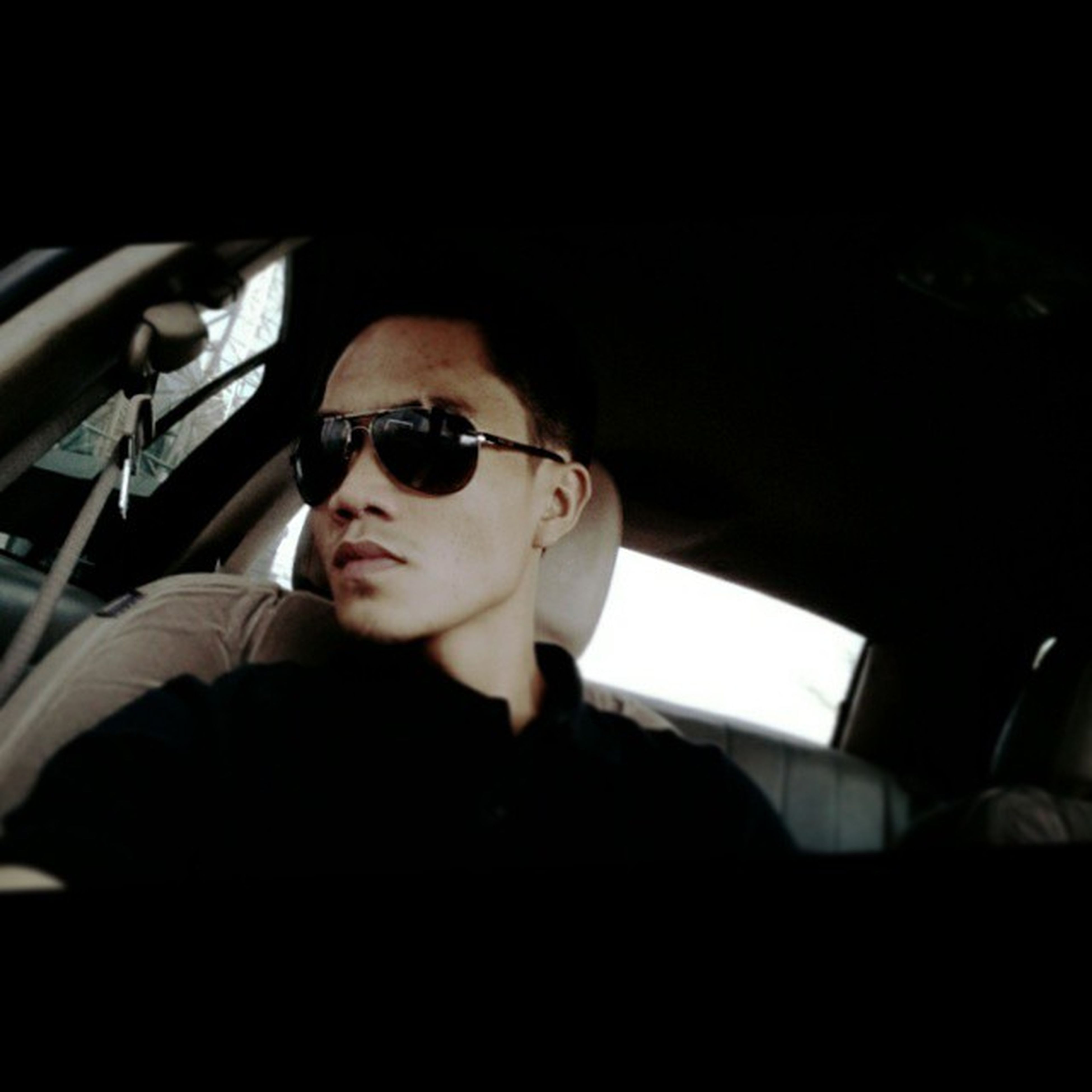young adult, looking at camera, portrait, lifestyles, person, indoors, headshot, sunglasses, leisure activity, front view, transportation, vehicle interior, young men, car, car interior, mode of transport, head and shoulders