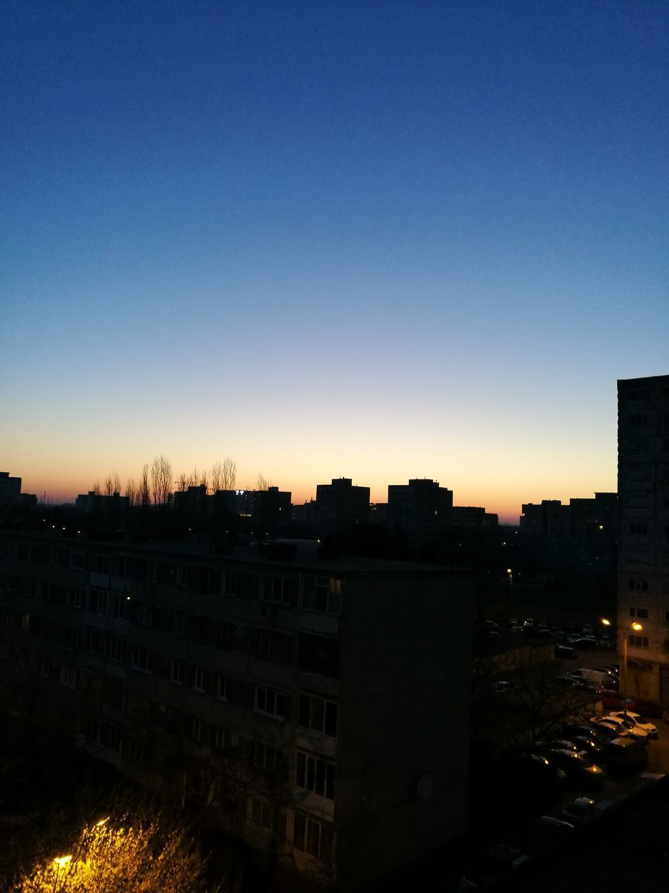 sunset, architecture, clear sky, no people, silhouette, building exterior, city, cityscape, sky, outdoors, nature
