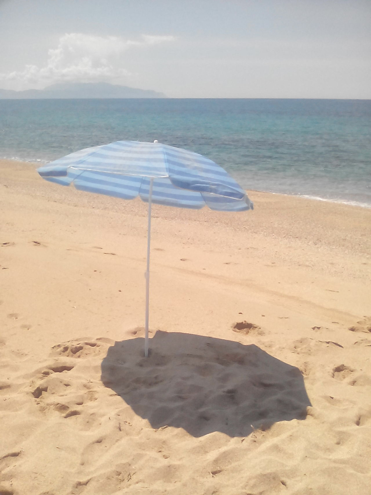 SunshineGetting A Tan Relaxing Unbrella Sand Enjoying The Sun Sea Being A Beach Bum The Essence Of Summer