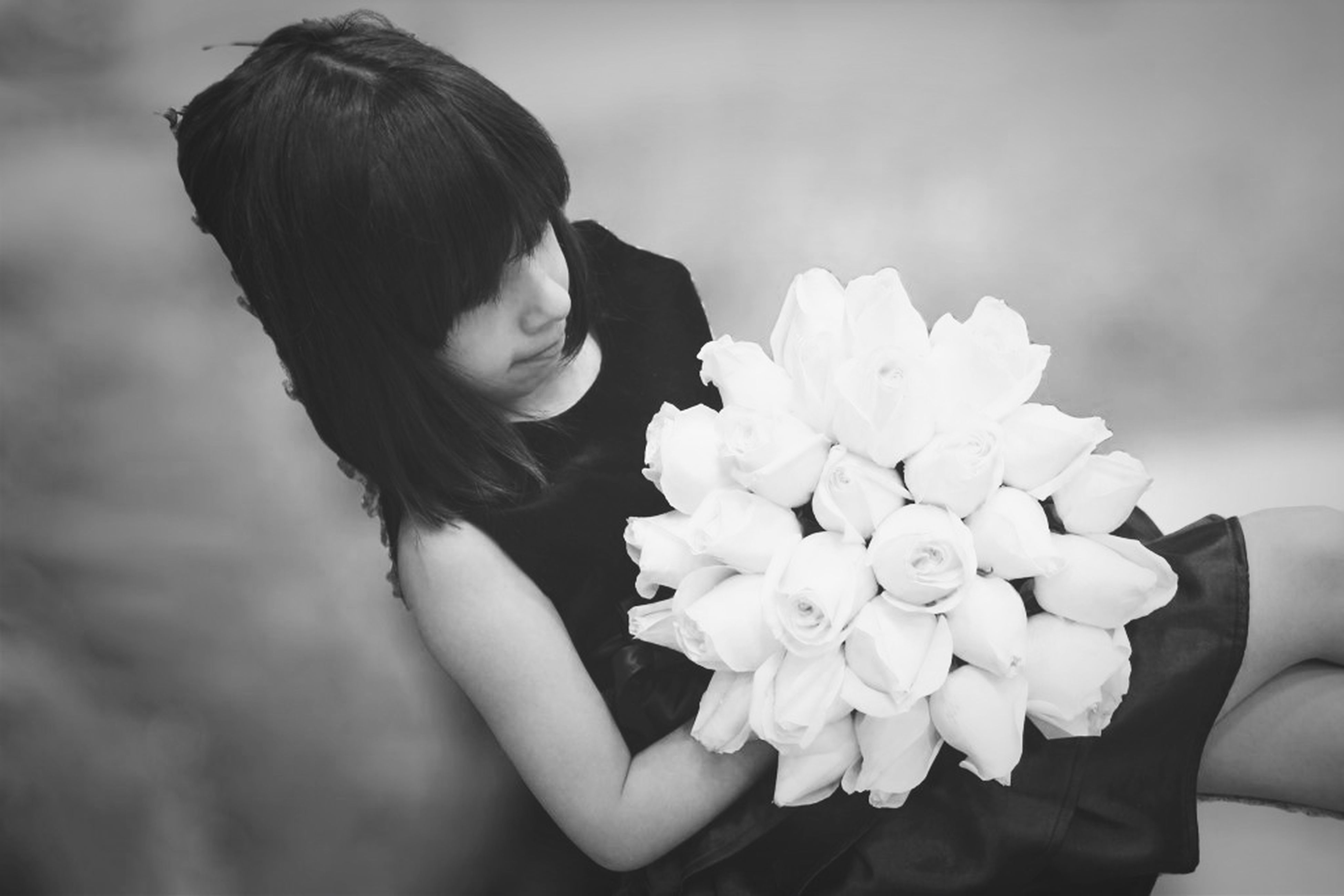 flower, lifestyles, holding, focus on foreground, fragility, flower head, leisure activity, freshness, person, petal, young women, long hair, beauty in nature, close-up, young adult, nature, standing