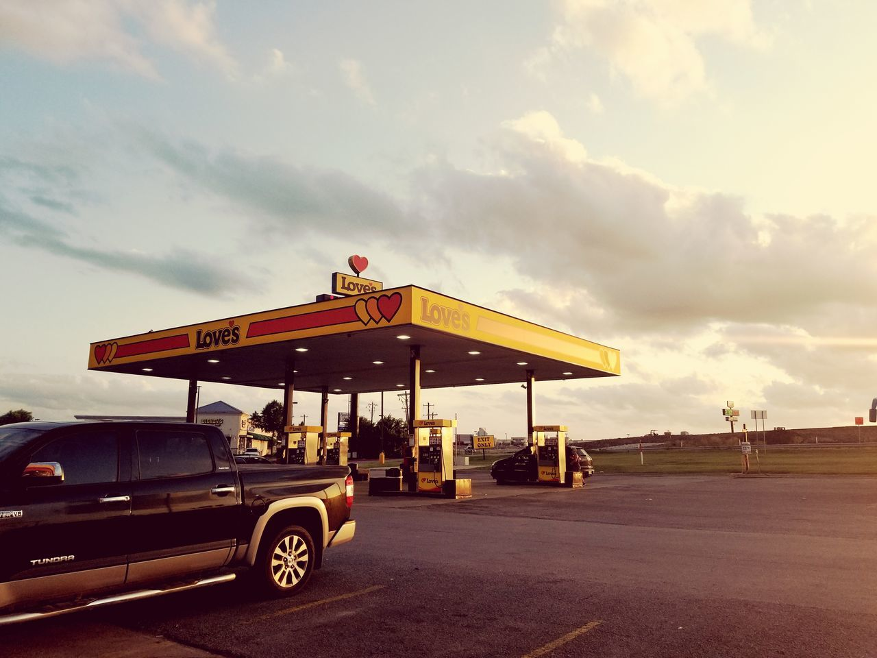 transportation, land vehicle, gas station, sky, cloud - sky, fuel pump, mode of transport, built structure, outdoors, gasoline, day, architecture, no people, oil pump